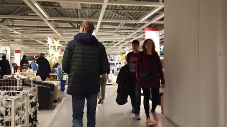 raf : MOSCOW, RUSSIA - NOVEMBER 17, 2019: People in largest furniture retailer IKEA showroom.