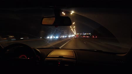 otoyol : Trip on a car on a night highway lit by flashlights