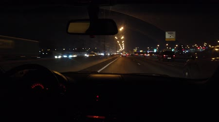time laps : Trip on a car on a night highway lit by flashlights