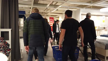 stockpile : MOSCOW, RUSSIA - NOVEMBER 17, 2019: People in largest furniture retailer IKEA showroom.