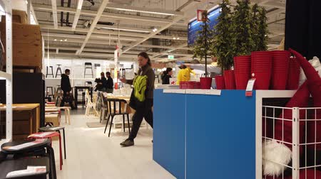аксессуары : MOSCOW, RUSSIA - NOVEMBER 17, 2019: People in largest furniture retailer IKEA showroom.