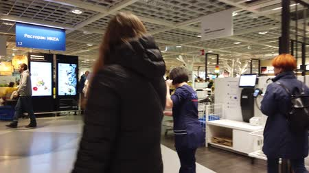 drive through : MOSCOW, RUSSIA - NOVEMBER 17, 2019: People in largest furniture retailer IKEA showroom.