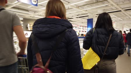 buono acquisto : MOSCOW, RUSSIA - NOVEMBER 17, 2019: People in largest furniture retailer IKEA showroom.