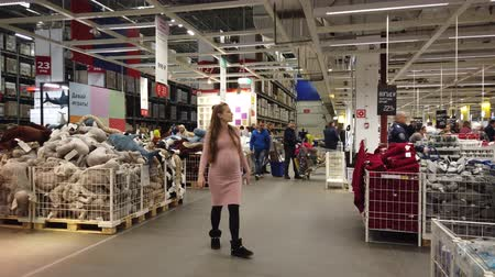 huge sale : MOSCOW, RUSSIA - NOVEMBER 17, 2019: People in largest furniture retailer IKEA showroom.
