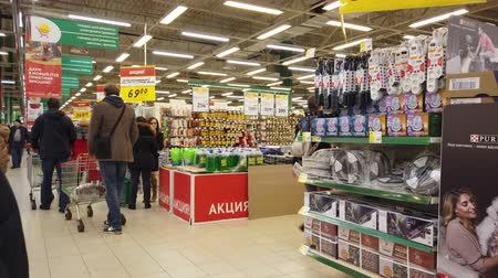 bazar : MOSCOW, RUSSIA - NOVEMBER 23, 2019: People walk around the supermarket in search of the right products. People in the food market.