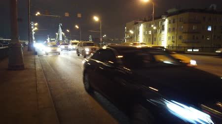multiple lane : MOSCOW, RUSSIA - 12 DECEMBER 2019: Evening city traffic in Moscow. Evening traffic jams in the city. Stock Footage