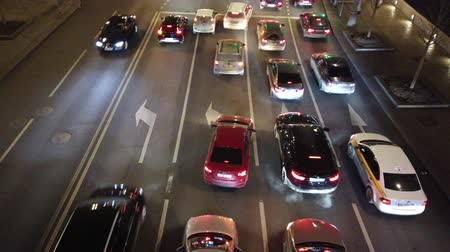 road sign : Evening city traffic at rush hour. City traffic jam at the intersection. Stock Footage