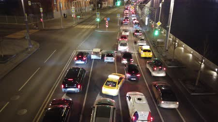 emperrado : Evening city traffic at rush hour. City traffic jam at the intersection. Vídeos