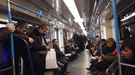 metropolitano : MOSCOW, RUSSIA - DECEMBER 12, 2019: People in the subway car. Moscow metro. Passengers sit in places with different activities. Stock Footage