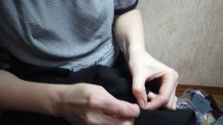 csip : Girl with needle manually sews their clothes Stock mozgókép