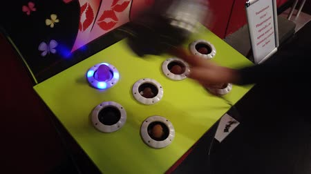 mole : Whack a mole game at amusement park close up Videos