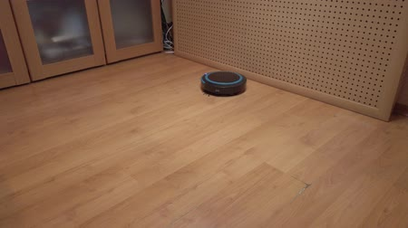 laminált : Robot vacuum cleaner rolls around the house, cleaning the house using electronics