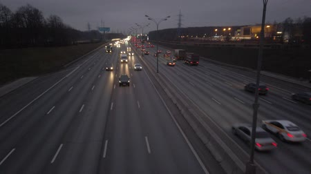 MKAD, cars go on the expressway in the evening. The track around Moscow