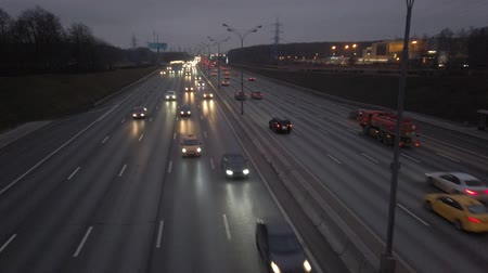 emperrado : MKAD, cars go on the expressway in the evening. The track around Moscow