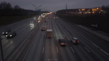 busy line : MKAD, cars go on the expressway in the evening. The track around Moscow
