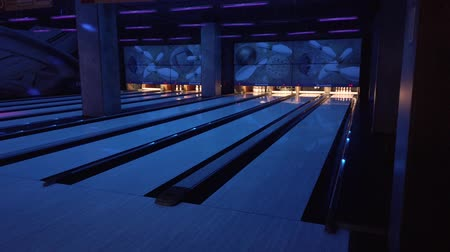 People play bowling, throw balls on the road of bowling