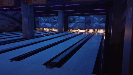 knock : People play bowling, throw balls on the road of bowling
