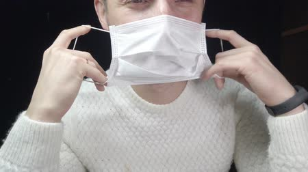 A man in a protective mask, a medical mask against the virus. Protection from infection Videos