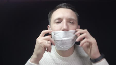 zsebkendő : A man in a protective mask coughs. The man is sick, colds, cough.