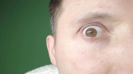 凝視 : Male eye close-up, pupil enlargement, blinking eyes 動画素材