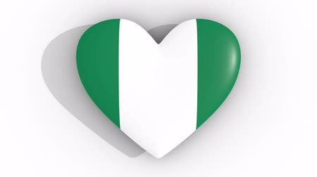 abuja : Pulsating heart in the colors of Nigeria flag, on a white background, 3d rendering top, loop Stock Footage