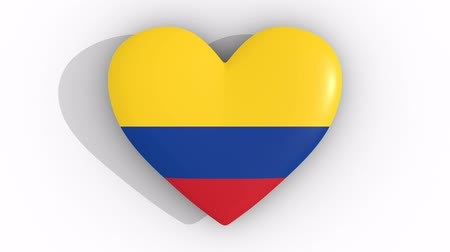 bogota : Pulsating heart in the colors of Colombia flag, on a white background, 3d rendering top, loop