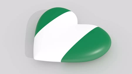 abuja : Pulsating heart in the colors of Nigeria flag, on a white background, 3d rendering side, loop