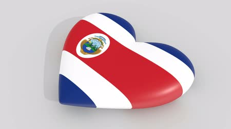 egemenlik : Pulsating heart in the colors of Costa Rica flag, on white background, 3d rendering side, loop Stok Video