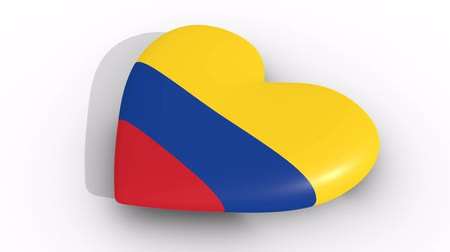bogota : Pulsating heart in the colors of Colombia flag, on white background, 3d rendering side, loop