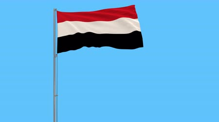 yemen : Flag of Yemen on the flagpole fluttering in the wind on a pure blue background, 3d rendering Stock Footage