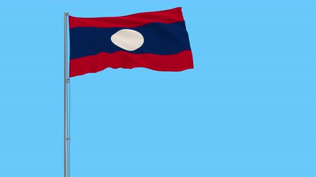 vientiane : Isolate flag of Laos on a flagpole fluttering in the wind on a transparent background, 3d rendering, 4k Stock Footage