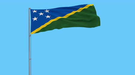 melanesia : Isolate flag of Solomon Islands on a flagpole fluttering in the wind on a transparent background, 3d rendering, 4k prores footage, alpha transparency