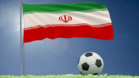 İslamiyet : Flag of Iran fluttering and a football rolls on the lawn, 3d rendering, 4k footage Stok Video