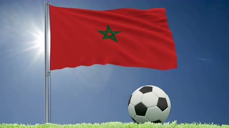 felhőtlen : Flag of Morocco fluttering and a football rolls on the lawn, 3d rendering, 4k footage