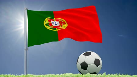 felhőtlen : Flag of Portugal fluttering and a football rolls on the lawn, 3d rendering, 4k footage