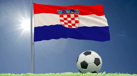 yugoslavia : Flag of Croatia fluttering and a football rolls on the lawn, 3d rendering, 4k footage Stock Footage