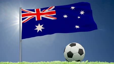 felhőtlen : Flag of Australia fluttering and a football rolls on the lawn, 3d rendering, 4k footage Stock mozgókép