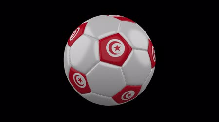 bola de futebol : Soccer ball with Tunisia flag colors rotates on transparent background, 3d rendering, prores 4444 with alpha channel, loop Vídeos