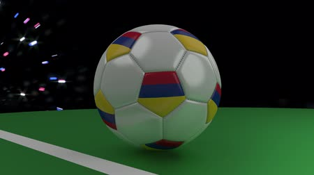 bogota : Soccer ball with the flag of Colombia crosses the goal line under the salute, 3D rendering