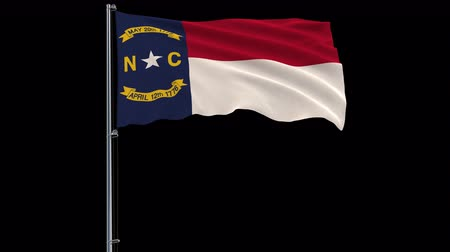 áttekinthetőség : IIsolate flag of United States North Carolina on flagpole fluttering in wind, 3d rendering, 4k prores 4444 footage with alpha transparency