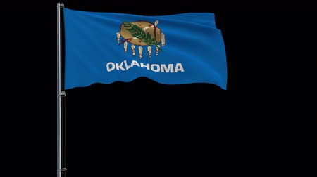 oklahoma : IIsolate flag of United States Oklahoma on flagpole fluttering in wind, 3d rendering, 4k prores 4444 footage with alpha transparency Stock Footage