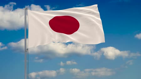 tokyo government : Flag of Japan against background of clouds floating on the blue sky