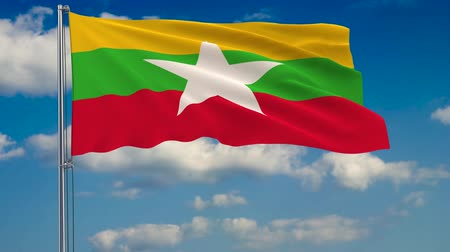 флагшток : Flag of Myanmar against background of clouds floating on the blue sky