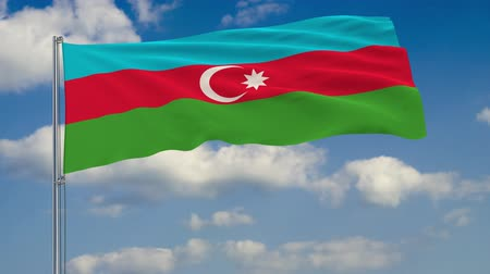 baku : Flag of Azerbaijan against background of clouds floating on the blue sky. Stock Footage