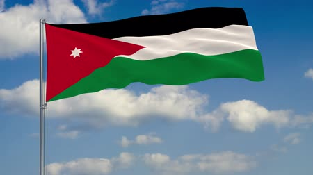 Ürdün : Flag of Jordan against background of clouds floating on the blue sky.
