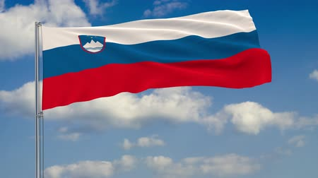 ljubljana : Flag of Slovenia against background of clouds floating on the blue sky.