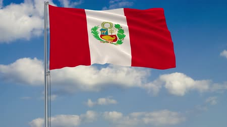 lima : Flag of Peru against background of clouds floating on the blue sky