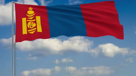 moğolistan : Flag of Mongolia against background of clouds floating on the blue sky Stok Video