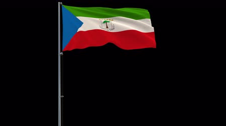 gine : Isolate big flag of Equatorial Guinea on a flagpole fluttering in the wind on a transparent background, 3d rendering, 4k prores 4444 footage with alpha transparency
