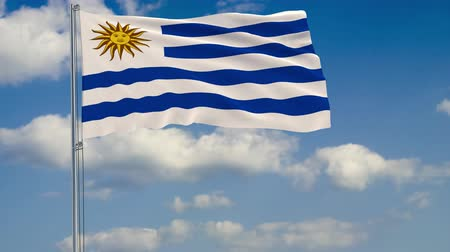 zászlórúd : Flag of Uruguay against background of clouds floating on the blue sky